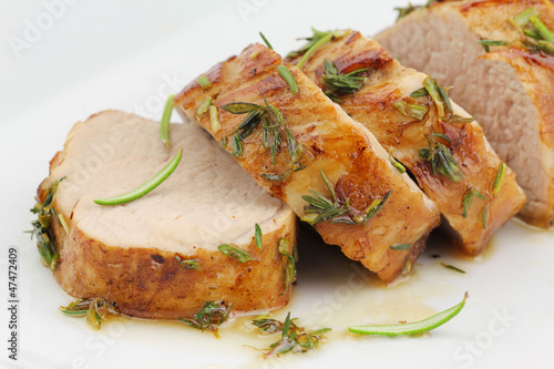 Sliced pork tenderloin or sirloin in herbs and honey glaze