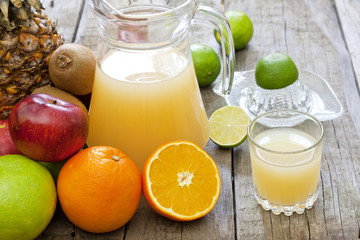 Fresh fruits juice with squeezer mixed assortment