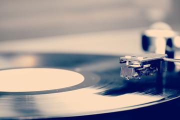 Spinning vinyl record. Motion blur image.  Vintage toned.