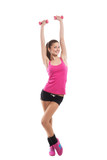 Fit girl raising dumbbells up and smiling, white background