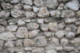 Horizontal wall consisting of naturel stacked gray stone