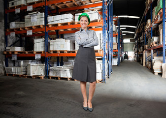 Confident Female Supervisor At Warehouse