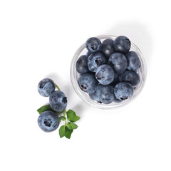 Blueberries in in a small glass, isolated