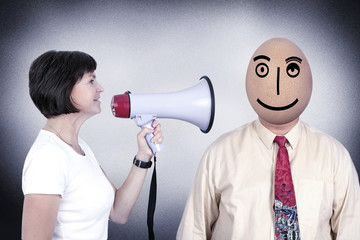 Woman with megaphone speaking to a man with egg head