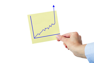 Hand holding paper with rising chart