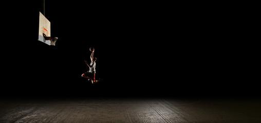 Nighttime basketball player