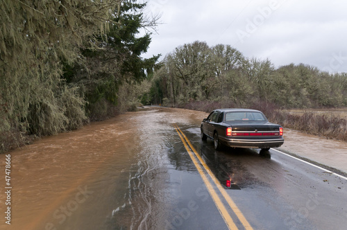 Car driving on flooded road - 47478666
