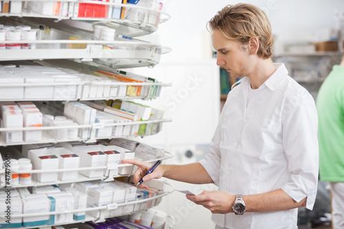 Male Pharmacist Filling Prescription