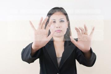 Business lady pushing keyboard on the whiteboard.