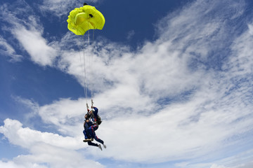 Filling the yellow parachute. Tandem jump.