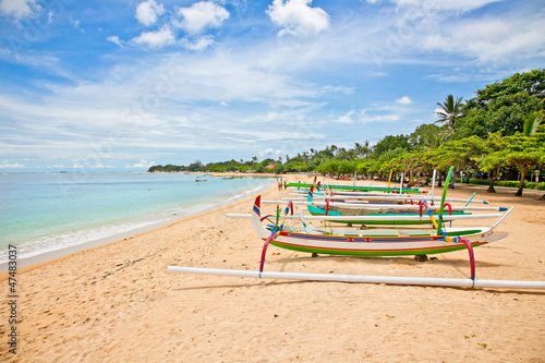 Beautiful tropical beach with fisherman's boats in Nusa Dua on B - 47483037
