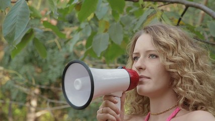 Beautiful girl speaks in a megaphone