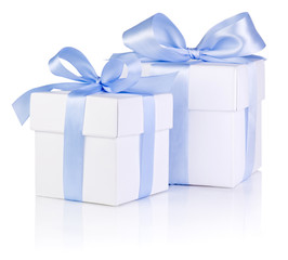 Two White boxs tied with a Blue satin ribbon bow Isolated on whi