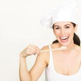 Köchin mit Kochlöffel