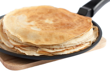 thin dairy pancakes in a frying pan