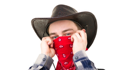 Young handsome cowboy with balaclava