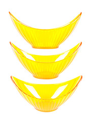 Three halfmoonlike yellow transparent vases