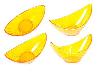 Four halfmoonlike yellow transparent vases