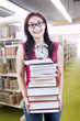 Happy student with books and clock