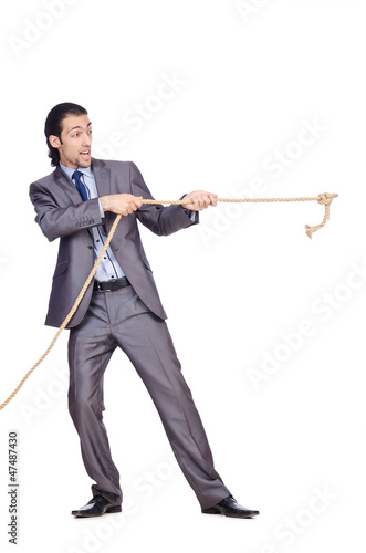 Businessman pulling rope on white