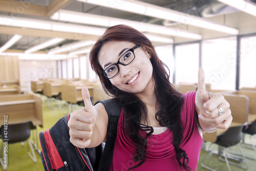 Happy student with thumbs up