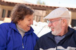 Happy Senior Adult Couple Bundled Up Outdoors
