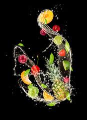 Fresh fruits falling in water splash on black background