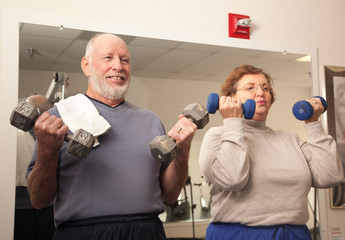 Senior Adult Couple Working Out in the Gym