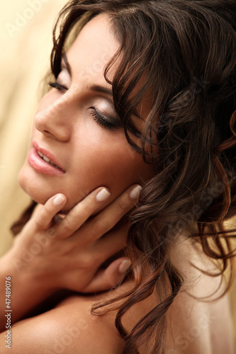 Art portrait of beautiful and attractive woman with curls