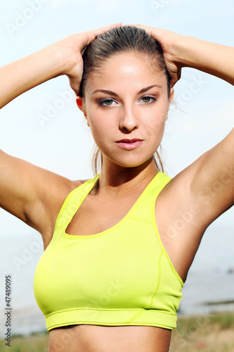 Portrait of beautiful sporty woman on a beach