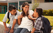 Hispanic Brothers and Sister Talking Ready for School - 47489227