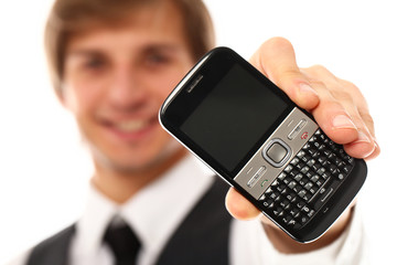 Handsome smiling man showing cellphone