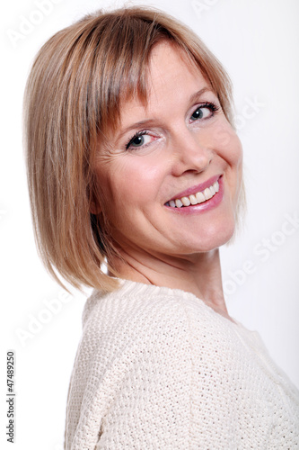 Portrait of good looking mid aged woman