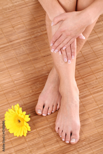 Barefoot feets with good skin and flower close up