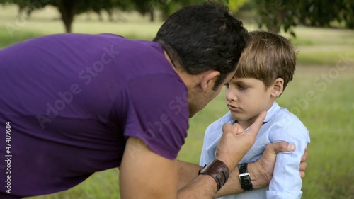 Parenthood and children education, angry man scolding boy