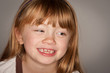 Fun Portrait of an Adorable Red Haired Girl on Grey