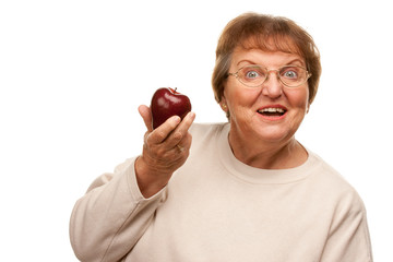 Attractive Senior Woman with Red Apple.