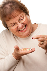 Attractive Senior Woman and Medication Pills.