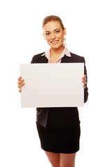 Positive business woman holding white board