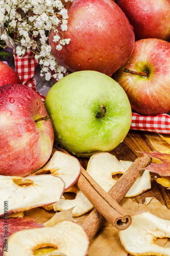 Fresh apples and dried apple slices