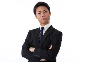businessman thinking with his arms folded