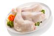 Raw chicken legs on white background