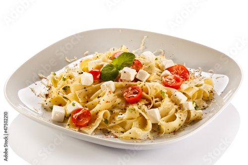 Pasta with tomato and white cheese