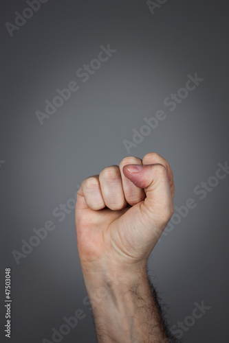 Fist pointing upwards
