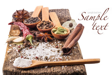 Collection of Spices on wooden table on white background