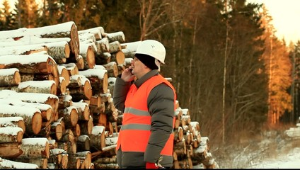 Lumberjack calling by cell phone