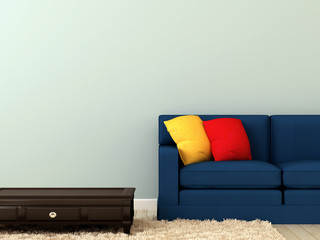 Blue sofa with colorful pillows and a coffee table