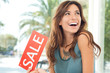 Happy Woman Holding Sale Sign