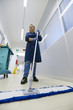 Women at workplace, professional female cleaner sweeping floor i