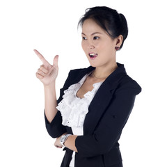 Cheerful business woman showing blank area for sign or copyspace